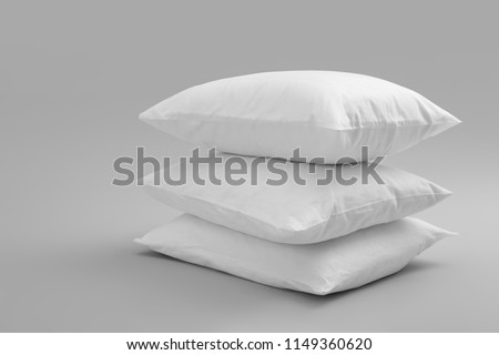 Clean soft bed pillows on grey background