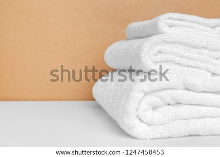 Clean soft towels on color background #1247458453