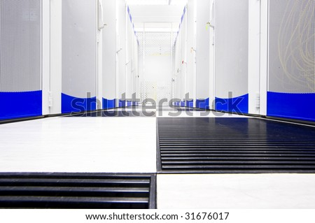 Clean suite in a data center with the perforated doors of server racks