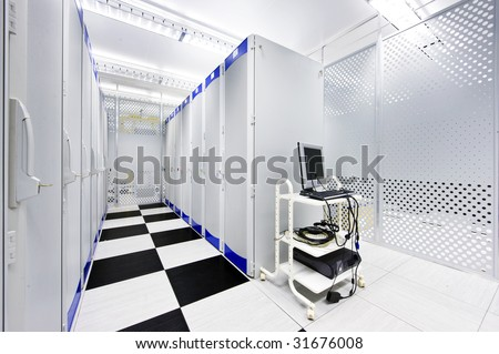 Clean suite in a data center with the perforated doors of server racks and a computer cart