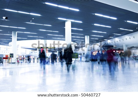 clean tiled floor, reflection of light on floor and blurred view of people walking