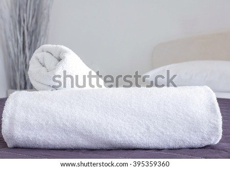 Clean towels on bed in hotel room #395359360