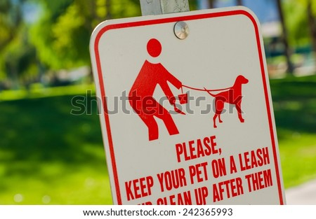 Clean Up After Pet Sign. Please Keep Your Pet on Leash and Clean Up After Them. Park Sign.