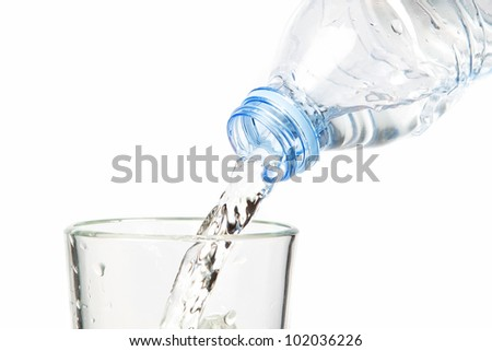 Clean water flowing into the bottle. On a white background.