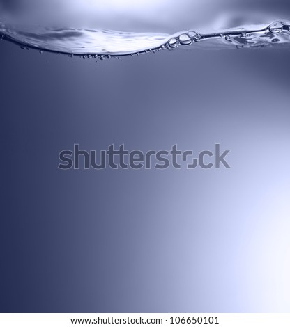 Clean water wave with bubbles.