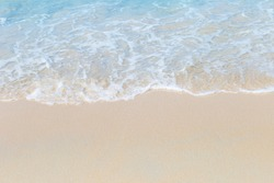 Clean white fine sand beach, white wave on clean beach, nature outdoor day light, summer concept background