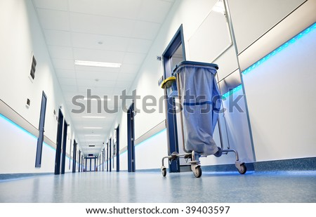 clean white long hospital corridor with blue leading lights