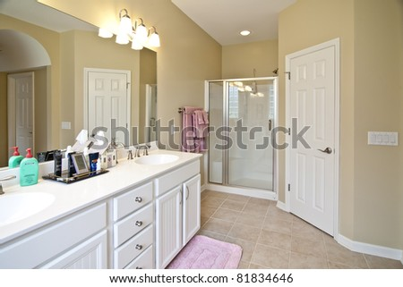clean, white residential bathroom with shower