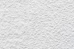 Clean white seamless concrete pebble-dash wall background texture.