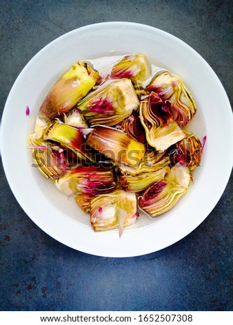 Cleaned artichokes and put in water and lemon