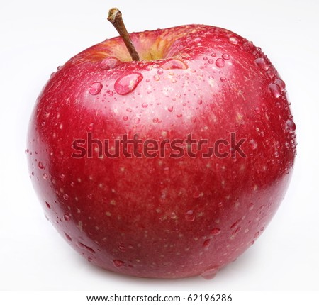 Cleaned red apple with water drops on it. Isolated on a white background.