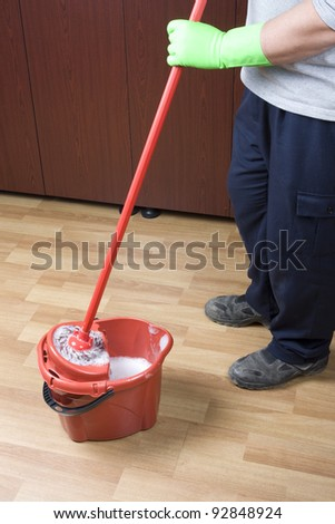 cleaner mopping floor in office