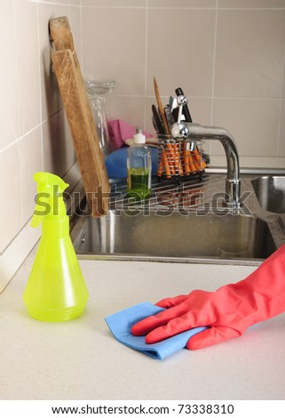 cleaning a dirty kitchen sink