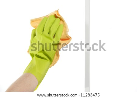 Cleaning a window by hand with a rag
