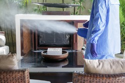 Cleaning and disinfecting: Key weapons in the fight against contagious diseases. Spray disinfection of surfaces in the house. Fogging with disinfectant due to coronavirus.