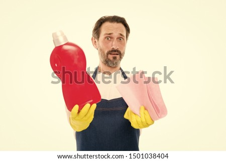 Cleaning and maintenance Senior man holding bottle of domestic cleaning fluid and wiper. Mature man doing household activity. Household worker. Household laundering. Providing household service. #1501038404