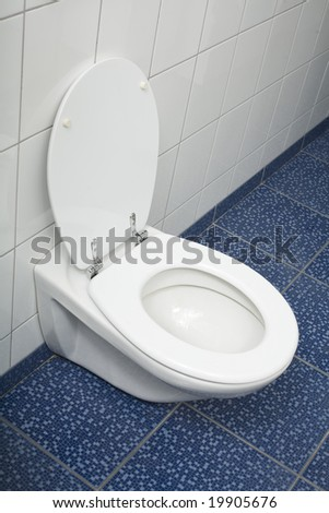 Cleaning and washing in a bathroom with white tiles