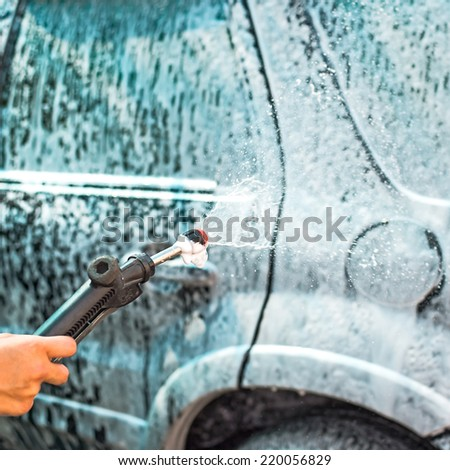 cleaning car by foam from clean care care service