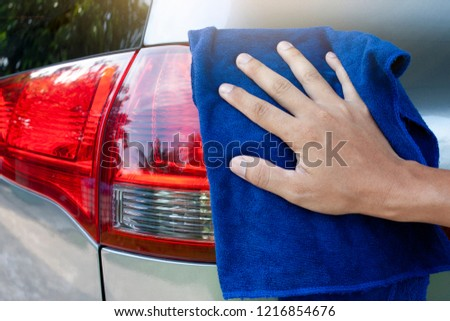 cleaning car on body from fabric by hand. #1216854676