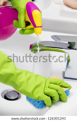 Cleaning cleaning bathroom sink with spray detergent housework spring cleaning concept