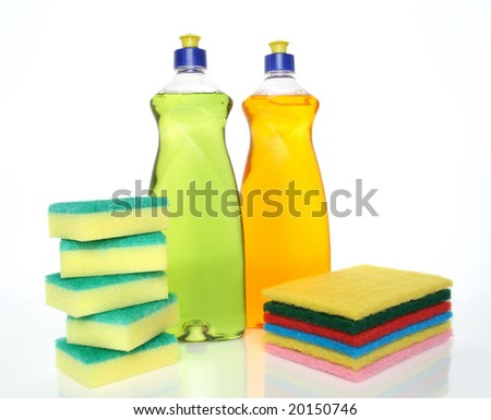 Cleaning concept. Dish washing liquid and sponges.
