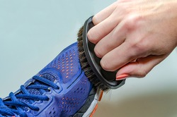 Cleaning dirty sneakers after training. Wash dirty sneakers. Wash your sneakers. Cleaning your trail running shoe.