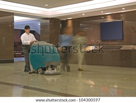 Cleaning floor in office building lobby