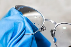 cleaning glasses lens to be clean, clear