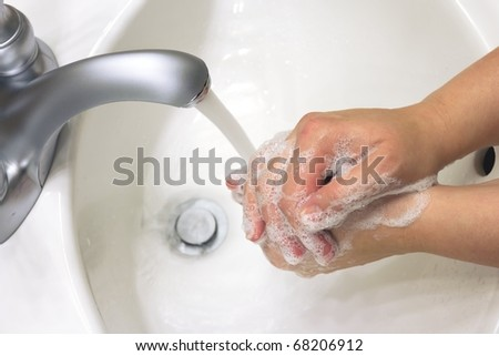 cleaning hands with soap