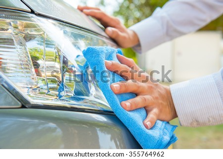 Cleaning headlight with microfiber cloth,car lights