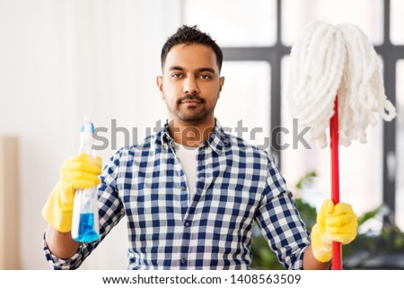 cleaning, housework and housekeeping concept - indian man with mop and detergent at home #1408563509