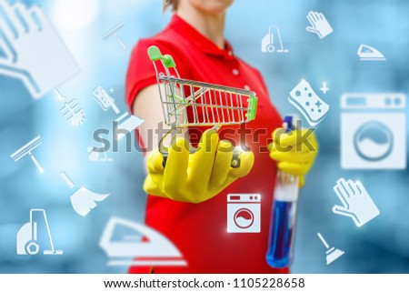 Cleaning lady is holding a basket on the background of the icons of cleaning. Concept shop of household chemicals. #1105228658
