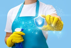 Cleaning lady shows sign of quality cleaning on a blue background.