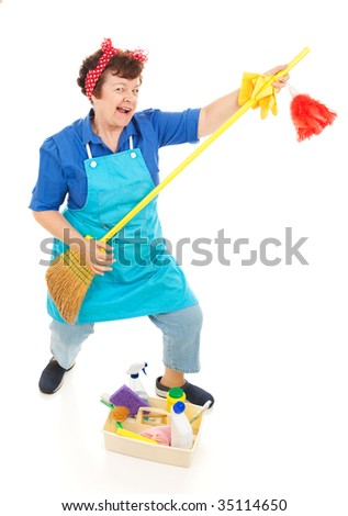 Cleaning lady takes a break to have some fun playing air guitar on her broom.  Full body isolated.
