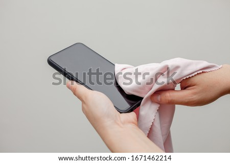 cleaning Mobile Phones for Covid-19 disease prevention. alcohol,disinfectant on Wipes of Smart Phone for safety,infection of Covid-19 virus,contamination,germs,bacteria that are frequently touched.