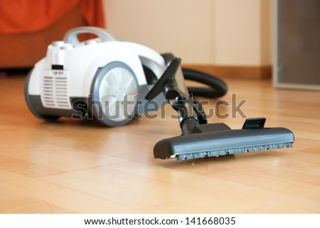 cleaning of the apartment vacuum cleaner on the floor