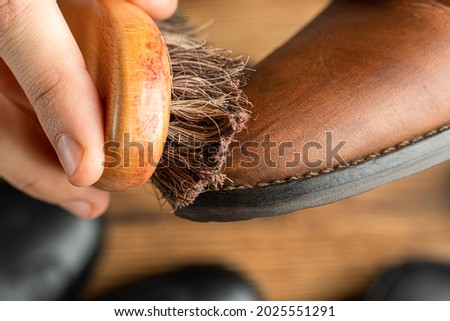 cleaning, polishing, restoration brown leather boots with brush and footwear care product, shoe polish Photo stock ©