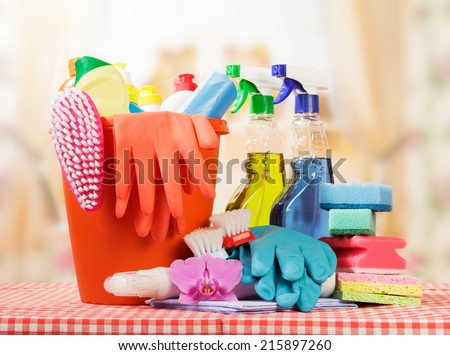 Cleaning products on table and kitchen background