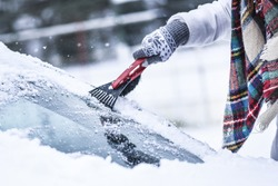 Cleaning snow from windshield, Scraping ice,  Winter car window cleaning