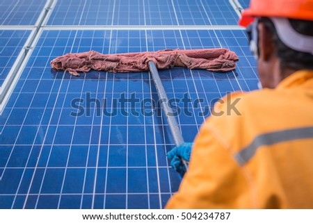 cleaning solar panel in solar power plant  #504234787