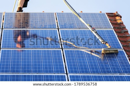 Cleaning solar panels with brush and water Photo stock ©