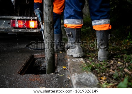 Photo of  Cleaning storm drains from debris, clogged drainage systems are cleaned with a pump and water