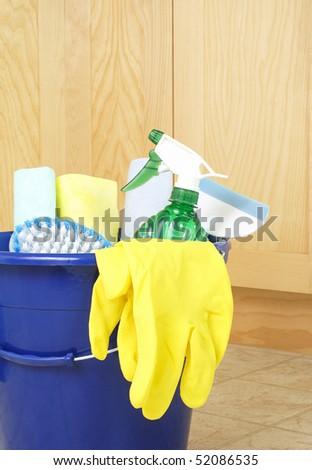 Cleaning supplies on kitchen floor in bucket