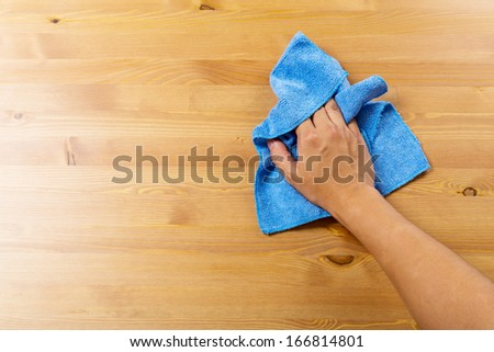 Cleaning table by blue rag