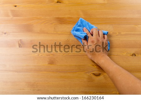 Cleaning table by hand #166230164