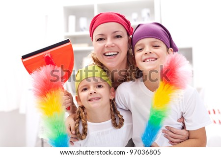 Cleaning task-force - woman with kids holding utensils