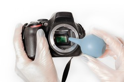 Cleaning the dust from the camera DSLR sensor.
