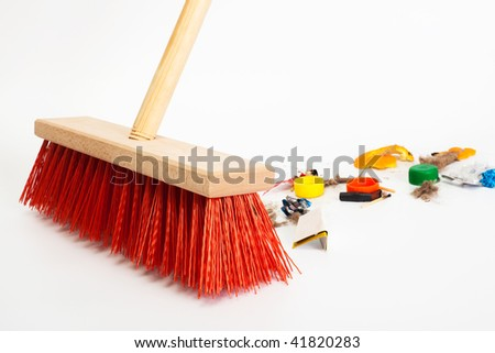 Cleaning the modern red broom mixed trash