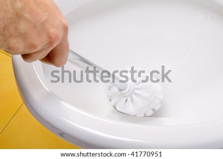cleaning toilet bowl