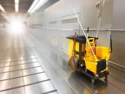 Cleaning tools cart park between walkway building.